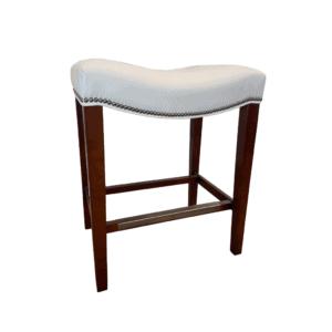 white leather saddle stool